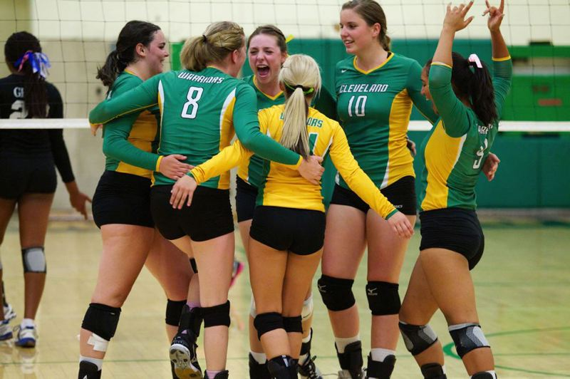 by: TRIBUNE PHOTO: JAIME VALDEZ - The Cleveland Warriors celebrate winning the first set in their 3-1 victory at home over Grant on Sept. 6.