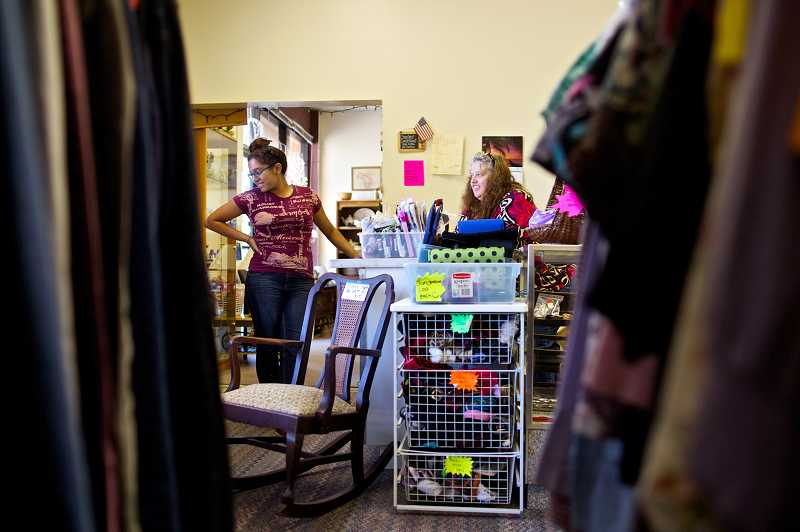 by: JAIME VALDEZ - Jackie Medina, 20, and her mom, Lori Keesis, help customers at Treasure Hunters thrift store in Aloha. Keesis started the store because her foster daughter, who has a learning disability, had problems finding a job.