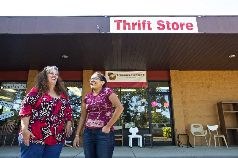 by: JAIME VALDEZ - Treasure Hunters thrift store owner Lori Keesis and her daughter Jackie Medina, 20, share a laugh in front of their Aloha store.