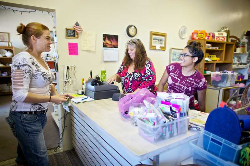 by: JAIME VALDEZ - Treasure Hunters thrift store owner Lori Keesis and her daughter Jackie Medina, 20, tend to Colby Littlejohn, who is a frequent customer of the Aloha store.
