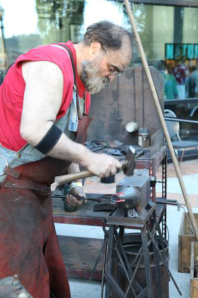 by: SUBMITTED PHOTO: OMSI - One of nearly 100 makers participating in the event, Red Troll Forging makes swords out of iron or steel using traditional blacksmith methods.
