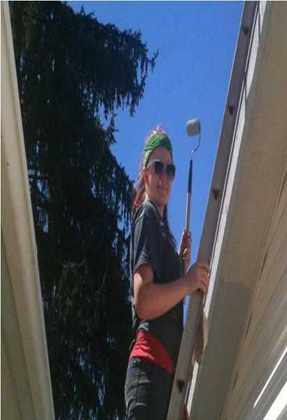 by: SUBMITTED PHOTO - Lindsay Spear spent part of her mission trip with Beaverton Christian Church painting a senior's home.
