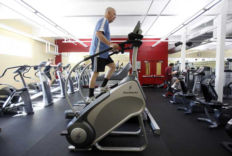 by: JONATHAN HOUSE - Buzz Bowman works out on a new stairmaster at the Garden Home Recreation Center on Friday.