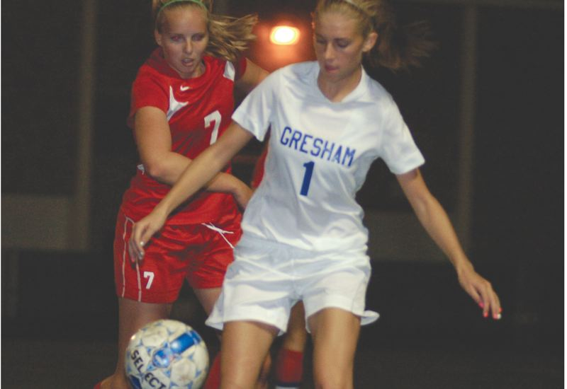 by: THE OUTLOOK: DAVID BALL - Greshams Bailey Allen settles the ball in the Centennial zone against Eagles midfielder Elise Morrow.