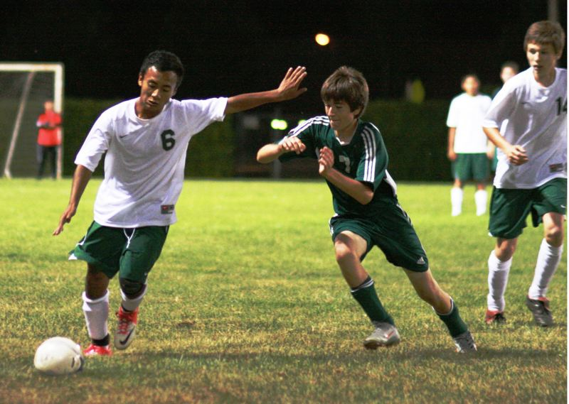 by: PHOTO BY LOREN NIBBE - Estacada freshman Anthony Cauich dominated play for the Rangers in the midfield despite playing in his first high school soccer game.