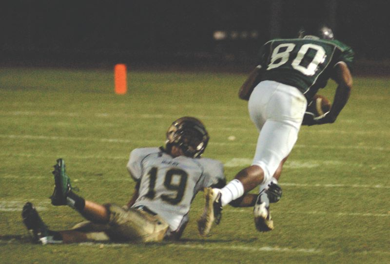 by: THE OUTLOOK: DAVID BALL - Reynolds receiver Quentin Bates knocks over McKays Armando Guevara for a big pick-up in the second quarter Friday night.