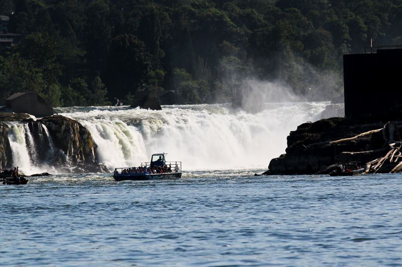 by: SUBMITTED PHOTO - A Willamette Jetboat is pictured next to Willamette Falls in Oregon City; an upper river tour is planned next weekend.
