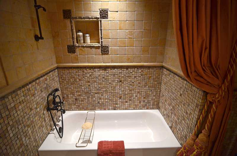 by: REVIEW, TIDINGS PHOTO: VERN UYETAKE - The glamarous alcove features an English-style handheld shower, ancient stone from Jerusalem and limestone.