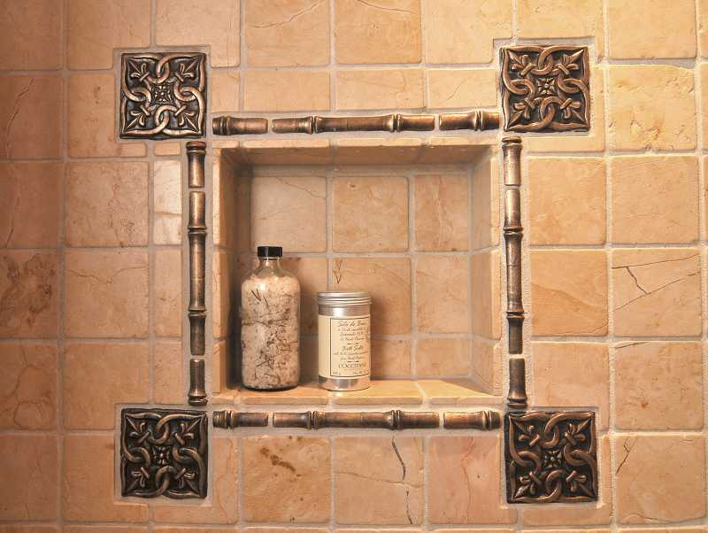 by: REVIEW, TIDINGS PHOTO: VERN UYETAKE - Limestone tile and bath salts add an intimate touch to the powder room.
