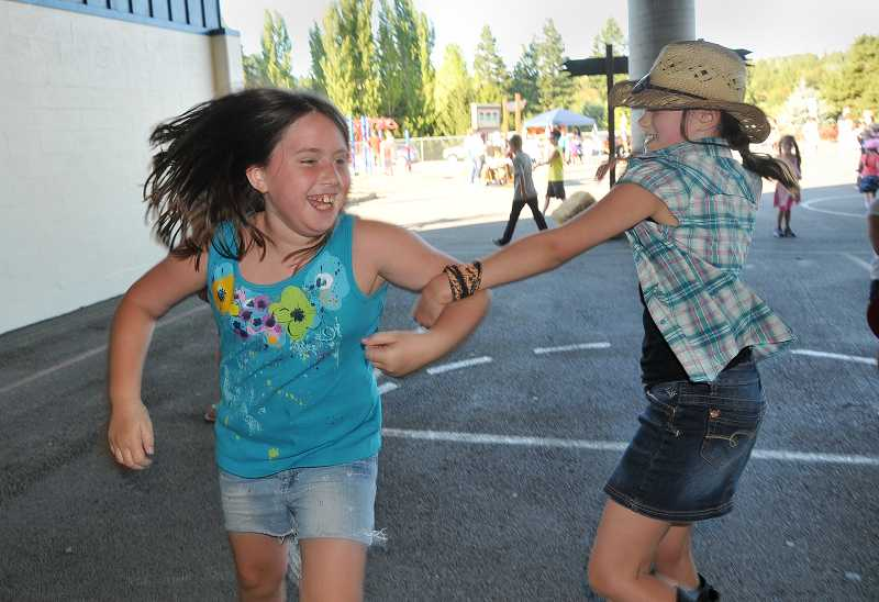 by: VERN UYETAKE  - Stafford fifth-graders Coryn Lundbom, left, and Jordan Bancroft dance up a storm at the Stafford Stampede.
