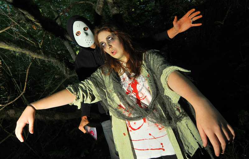 by: VERN UYETAKE - Mike Perkins nabbed Tori Smith as part of the scare tactics at last years Haunted Trail.