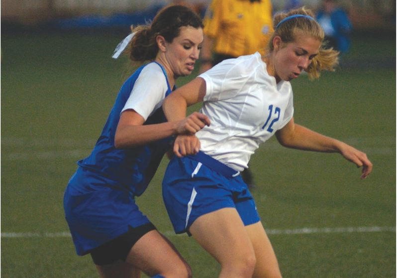 by: THE OUTLOOK: DAVID BALL - St. Marys Hayley Stutzman fights for a ball in the midfield against Greshams Jessie Stone during the Blues 1-0 win Tuesday at Buckman Field.