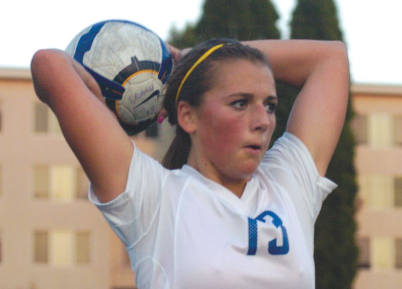 by: THE OUTLOOK: DAVID BALL - St. Marys defender Victoria Kirkland makes a throw-in during Tuesdays 1-0 home win over Gresham.