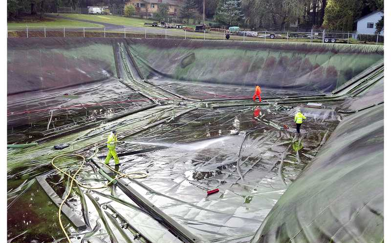 by: CITY OF WEST LINN - Workers conduct annual maintenance on the Bolton Reservoir. The facility is considered too small to handle current and future needs in West Linn.