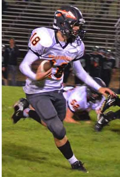 by: JOHN BREWINGTON  - Scappoose quarterback Taylor Loss has improved with each game this season and guided the Tribe to an easy win Friday.