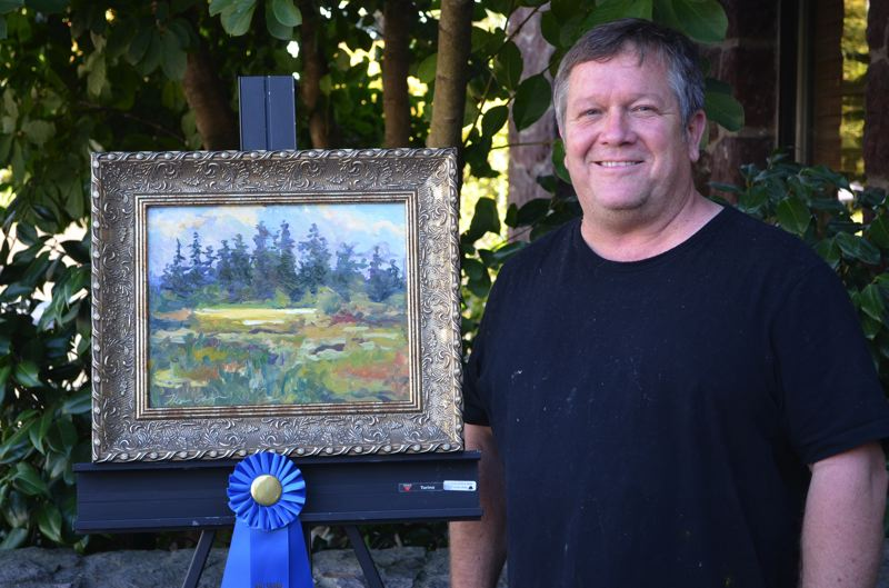 by: HILLSBORO ARTS & CULTURE COUNCIL - Scappoose resident Thomas Clark poses next to his first-place entry in a recent painting competition. It was completed on scene over two days.