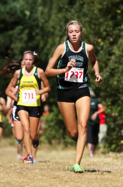 by: JOHN SCHRAG - TIGER ON THE GO -- Tigard's Elizabeth Dean strides out during Saturday's Festival of Champions.