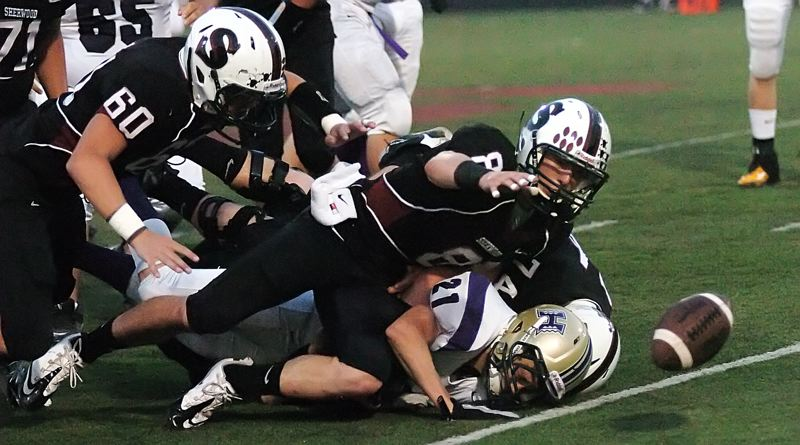 by: DAN BROOD - LOOSE BALL -- Sherwood junior Andrew Rice (60) and senior Joseph Balfour go after a Hermiston fumble.