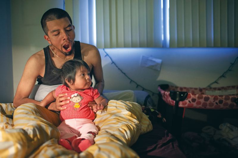 by: TRIBUNE PHOTO: CHRISTOPHER ONSTOTT - Omar Salazar, 17, wakes up early with his baby, Aleyna, who turns 1 next month. Omar juggles his jobs as student, busser, father, boyfriend, and musician in the school band.