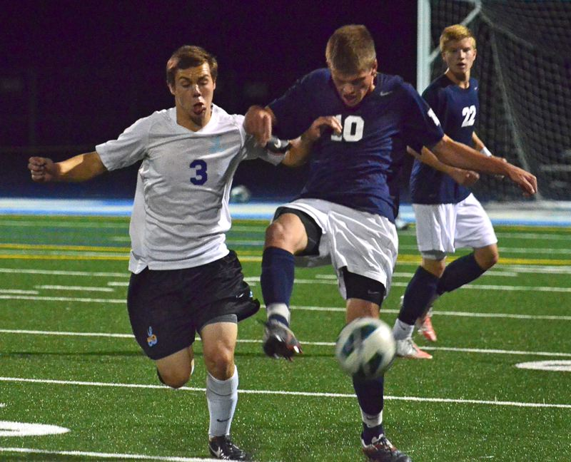 by: VERN UYETAKE - Lake Oswego's Blair Dozois, left, and Lakeridge's Michelle Dupre battle for a ball in the second half of Tuesday's Civil War game. The Pacers struck early and rolled to a 4-1 victory over the Lakers at home.