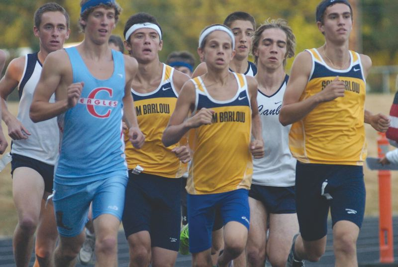 by: THE OUTLOOK: DAVID BALL - Centennials Taylor Hybl, far left, would eventually overtake Barlows lead pack to win the boys 5K in 16:26.