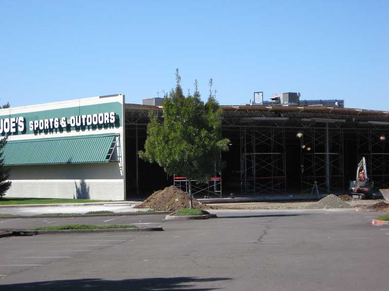 by: RAY PITZ - RENOVATION TIME - The front of the old Joe's store lies exposed as contractors work to expand the front of the store for the new Kohl's Department Store.