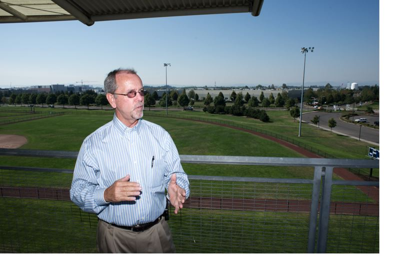 by: HILLSBORO TRIBUNE PHOTO: CHASE ALLGOOD -  Hillsboro Parks & Recreation Facilities Manager Gary Wilson shows off the location of the new Hillsboro Stadium.