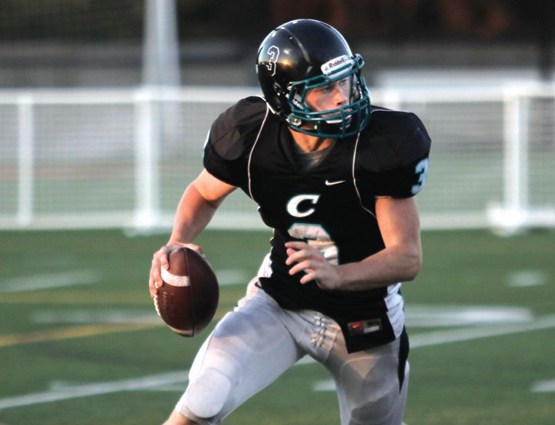 by: STAFF PHOTO BY JAIME VALDEZ - Century quarterback Sam Riddle rolls out during a non-league game against Lincoln on Aug. 31.