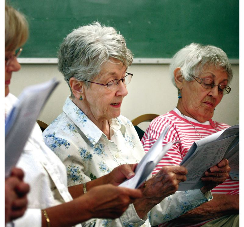 Members of the Senior Studies Institute's play reading class Sept. 12 tackle different roles as they read 'Chamber Music,' a one-act play by Arthur Kopit. Barbara Guyse, left, and Louise Feldman, right, are among the readers.