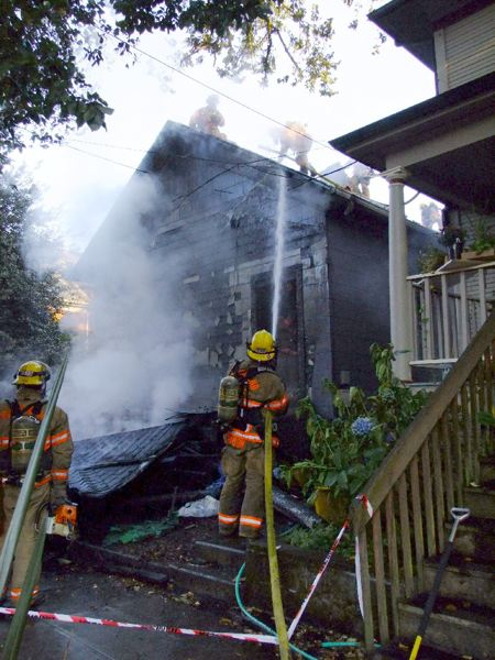 by: PORTLAND FIRE & RESCUE/DICK HARRIS - Overhead electric line increased risk to firefighters battling house fire