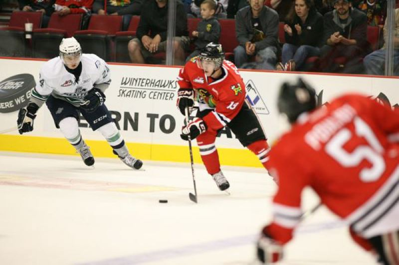 by: PORTLAND WINTERHAWKS - Portland Winterhawks center Nic Petan races up the ice in the season opener against Seattle.
