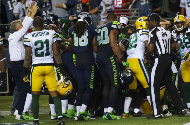 by: MICHAEL WORKMAN - Seattle Seahawks coach Pete Carroll (left) is in the end zone helping the NFL replacement officials make the call of touchdown as they try to unravel the final play Monday night against the Green Bay Packers.