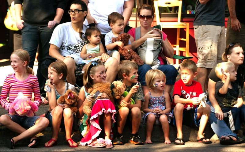 by: OUTLOOK FILE PHOTO: JIM CLARK - Teddy bear fans watch the Teddy Bear Parade in 2011.
