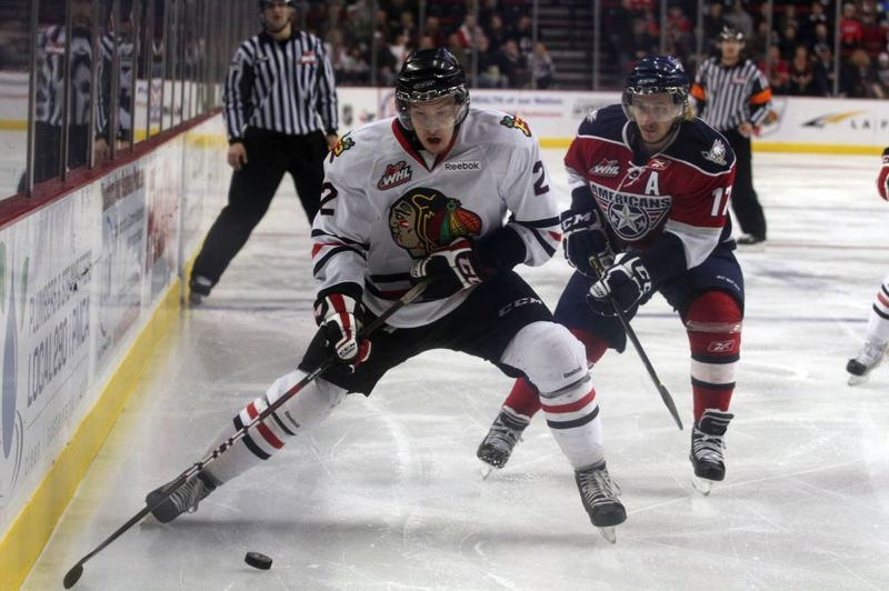by: TRIBUNE FILE PHOTO: JONATHAN HOUSE - Portland Winterhawks defenseman Troy Rutkowski swoops in to grab the puck in a game late last season against Tri-City.