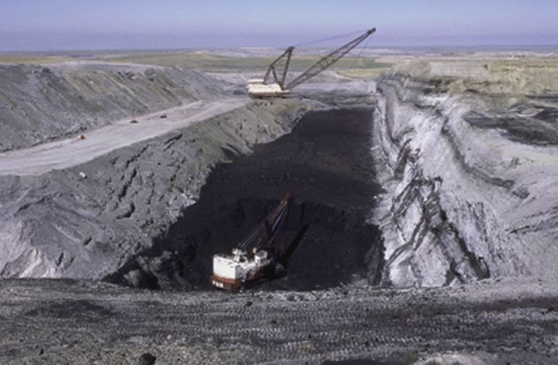 by: BUREAU OF LAND MANAGEMENT  - Coal is mined from Northeast Wyoming, part of the Powder River Basin, where Ambre Energy and other energy companies hope to start shipping coal from to Ports in the Northwest.