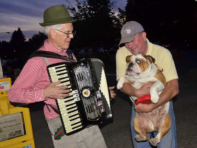 by: VERN UYETAKE - Lynn Halderman of the Oom Pah Boys entertained Chuck Toombs and his dog, Winston, last year.