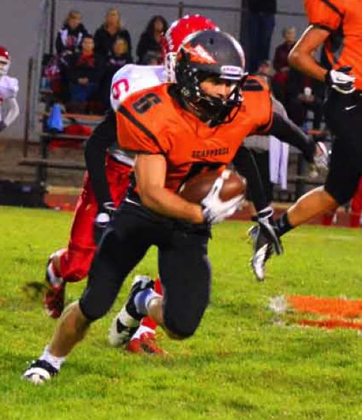 by: JOHN BREWINGTON - Scappoose's Paul Revis had over 300 yards of offense and scored four touchdowns in Friday's win over visiting Central.