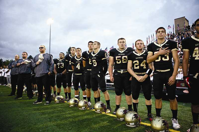 by: TIMES PHOTO: JAIME VALDEZ - The Southridge High School varsity football team honors the family of U.S. Army Pfc. Andrew Keller before their game Friday night against the Lake Oswego Lakers.