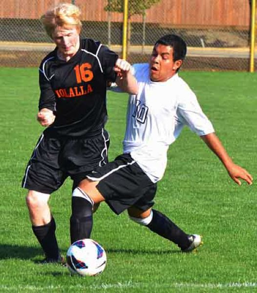 by: JOHN BREWINGTON - Scappoose's Jesus Martinez fights for the ball with Molalla's Aaron Glenn during a match last week.