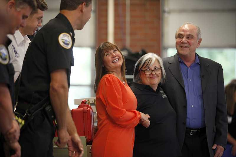 by: THE TIMES: JONATHAN HOUSE - Sandra Meekcoms, left, stands with her husband Raoul and emergency dispatcher Rita McQuiston. Rita instructed Sandra on how to provide CPR to Raoul after he suffered cardiac arrest on Aug. 12.