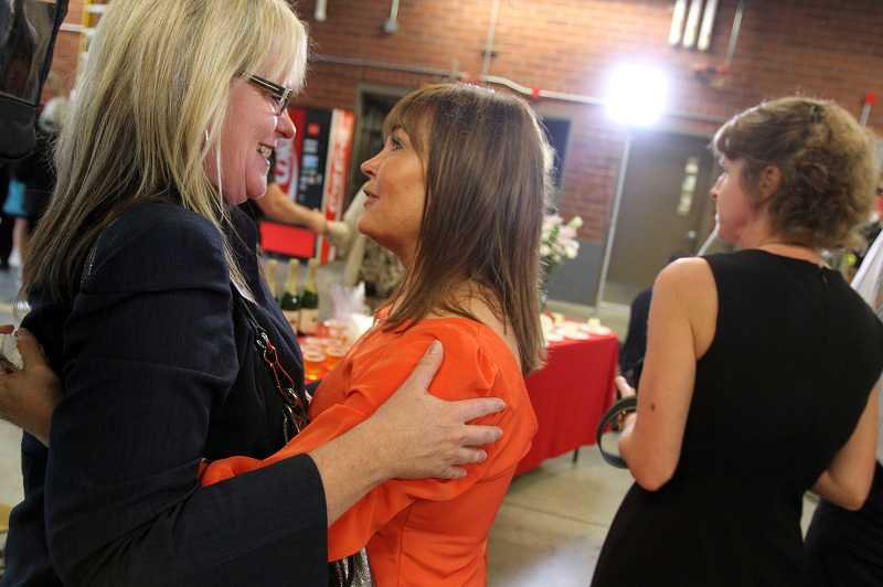 by: THE TIMES: JONATHAN HOUSE - Sandra Meekcoms, center, who saved her husbands life with CPR instructions given to her from a 911 operator, chats with her good friend Cheryl Dorman during a celebration that Tualatin Valley Fire and Rescue held Thursday to honor all of the emergency personnel who saved Raoul Meekcoms life.