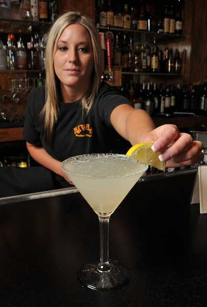 by: VERN UYETAKE - Handmade lemon drops are on special every day during happy hour.