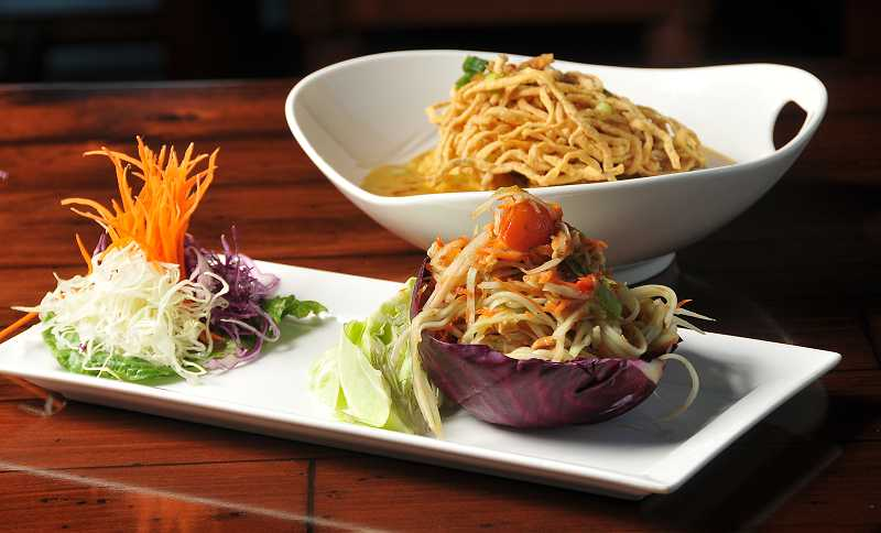 by: VERN UYETAKE - Som tum, a salad made of shredded green papaya, tomatoes, long beans and carrots tossed with lime juice and peanuts, reflects the food of eastern Thailand at Thai Linn. Behind it, a bowl of kao soi, a mix of crispy and soft egg noodles coated with a curry-coconut-milk sauce, shows a dish more common in northern parts of the country.