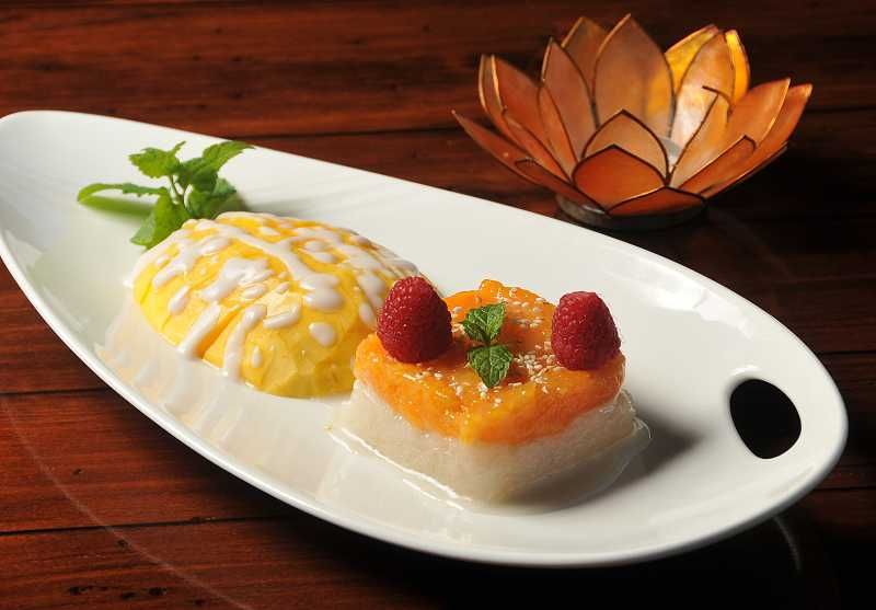 by: VERN UYETAKE - Thai Linn owner Lynn Luang likes to play with the presentation of her restaurant's dishes. Here, she has added color to sweet sticky rice and sculpted the vivid layers alongside slices of mango. A red raspberry garnish lends a bright pop of contrast.