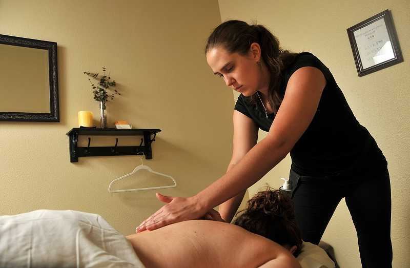by: VERN UYETAKE - Massage therapist Ramona Diprofio helps a client relax and relieve pain at Elements Therapeutic Massage.