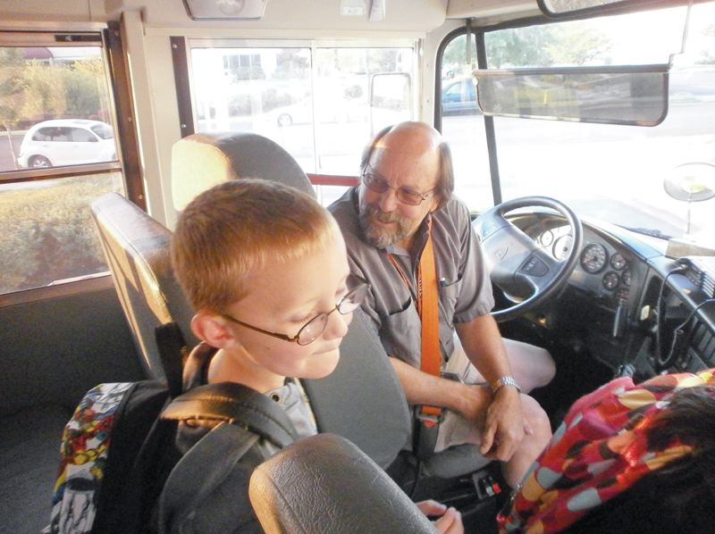 by: PHOTO BY NANCY TOWNSLEY/THE NEWS-TIMES - School bus driver Ken Prickett wishes first-grader Taylor Rogers a good day as he disembarks bus No. 197 at Quatama Elementary in Hillsboro. Prickett, 62, lives in Banks.