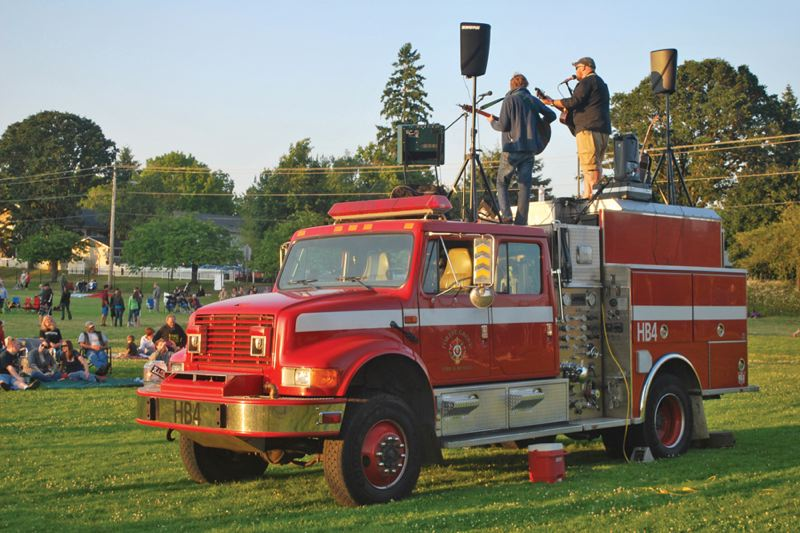 by: COURTESY FOREST GROVE FIRE & RESCUE - Josh Smith played atop a fire engine at the Forest Grove Fourth of July event. You can hear his new record Honey Badger on iTunes.