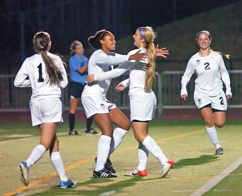 by: DAN BROOD - CELEBRATION -- Tualatin freshman Abbey Anderson (1), Ariana Pumpelly and Alyssa Durdel (2) congratulate Megan Landmark (second from right) following her goal against Corvallis.