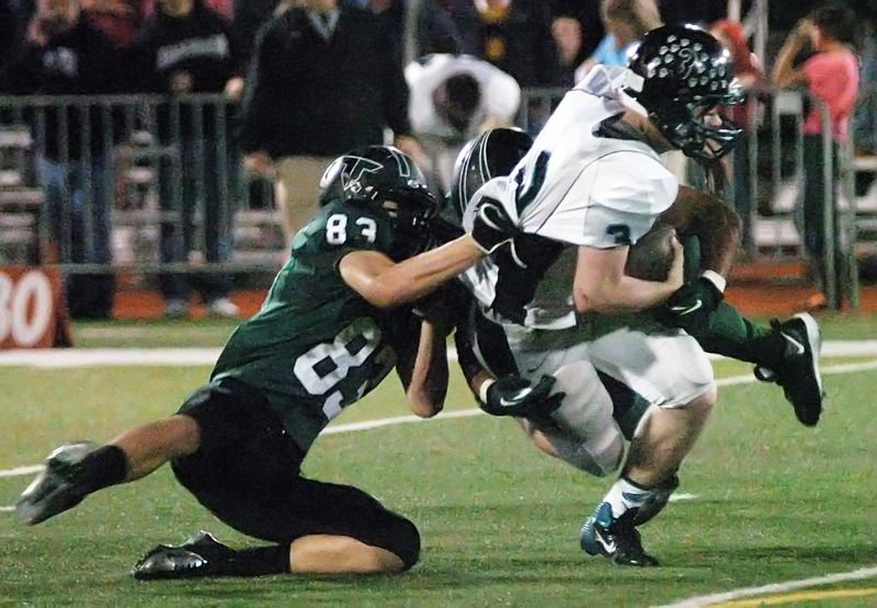 by: DAN BROOD - GOT HIM -- Tigard junior Nick Duron drags down Century quarterback Sam Riddle.