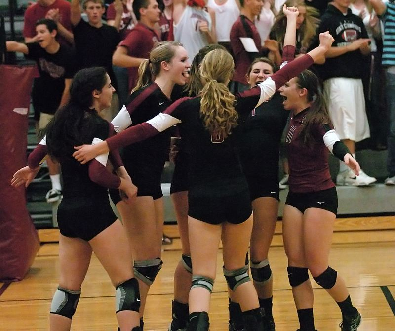 by: DAN BROOD - WE WIN -- The Sherwood High School volleyball team celebrates following its win over Liberty.
